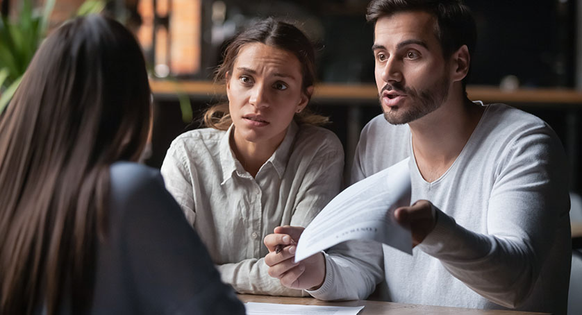Angry couple arguing with bank manager complain on bad contract