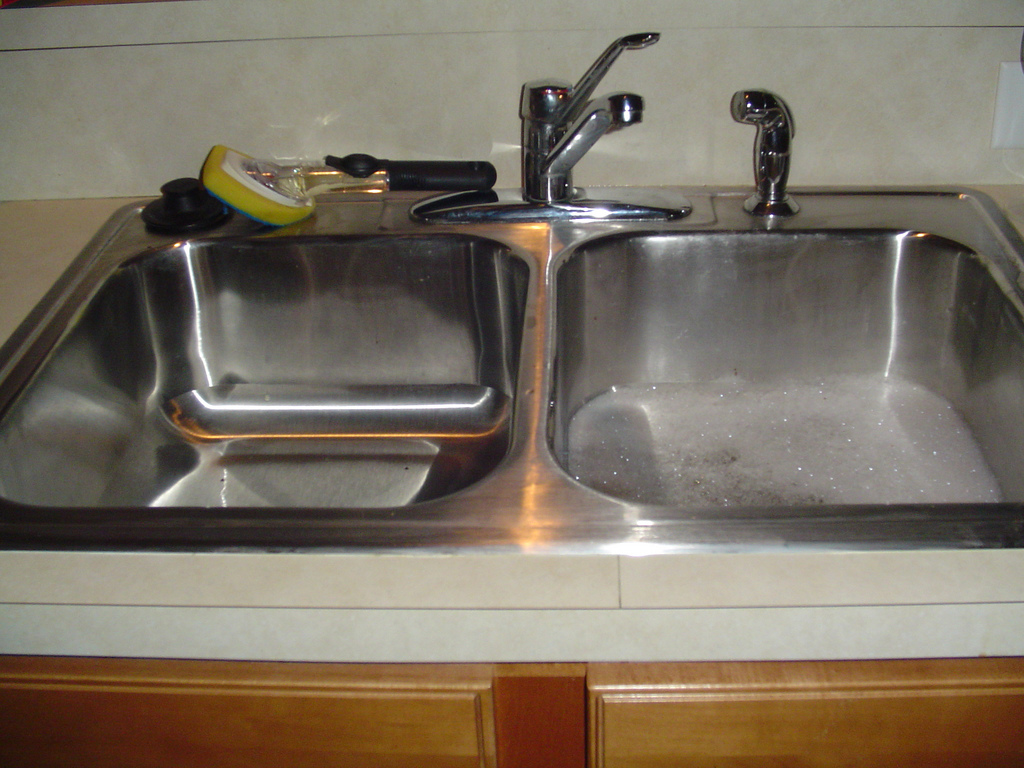 Dealing with common rental property maintenance issues - Clogged kitchen sink without garbage disposal ...