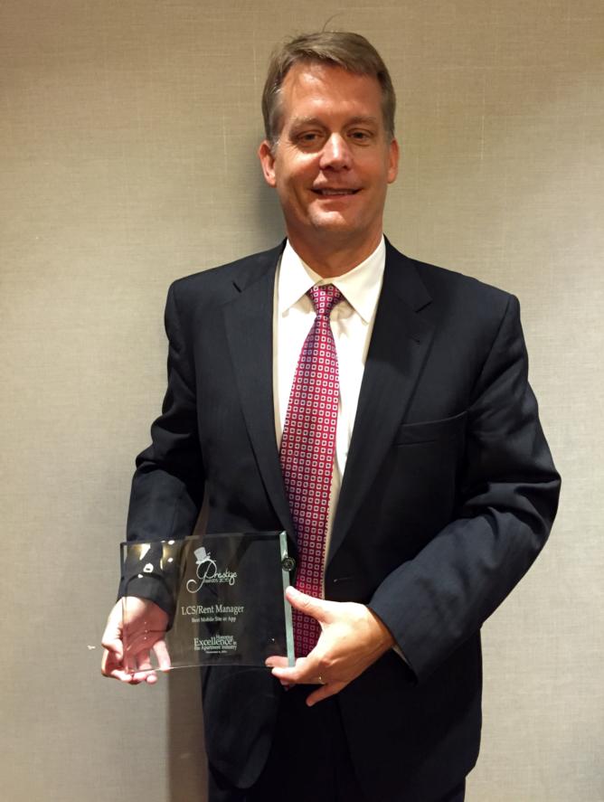 Dave holding Prestige Award