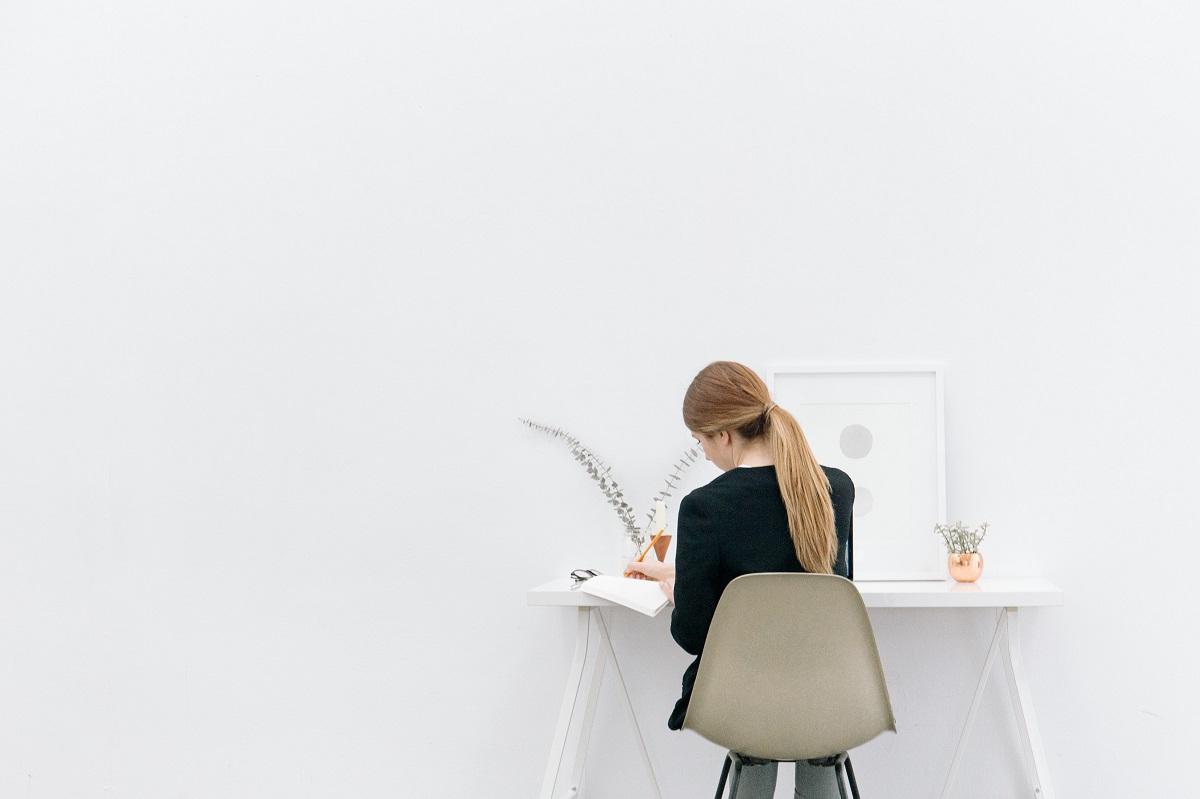 girl writing at desk