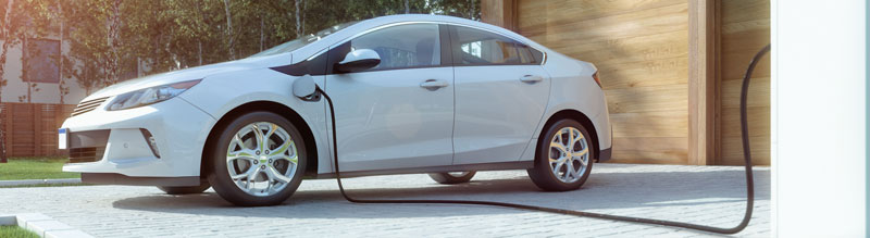 Electric vehicle in driveway