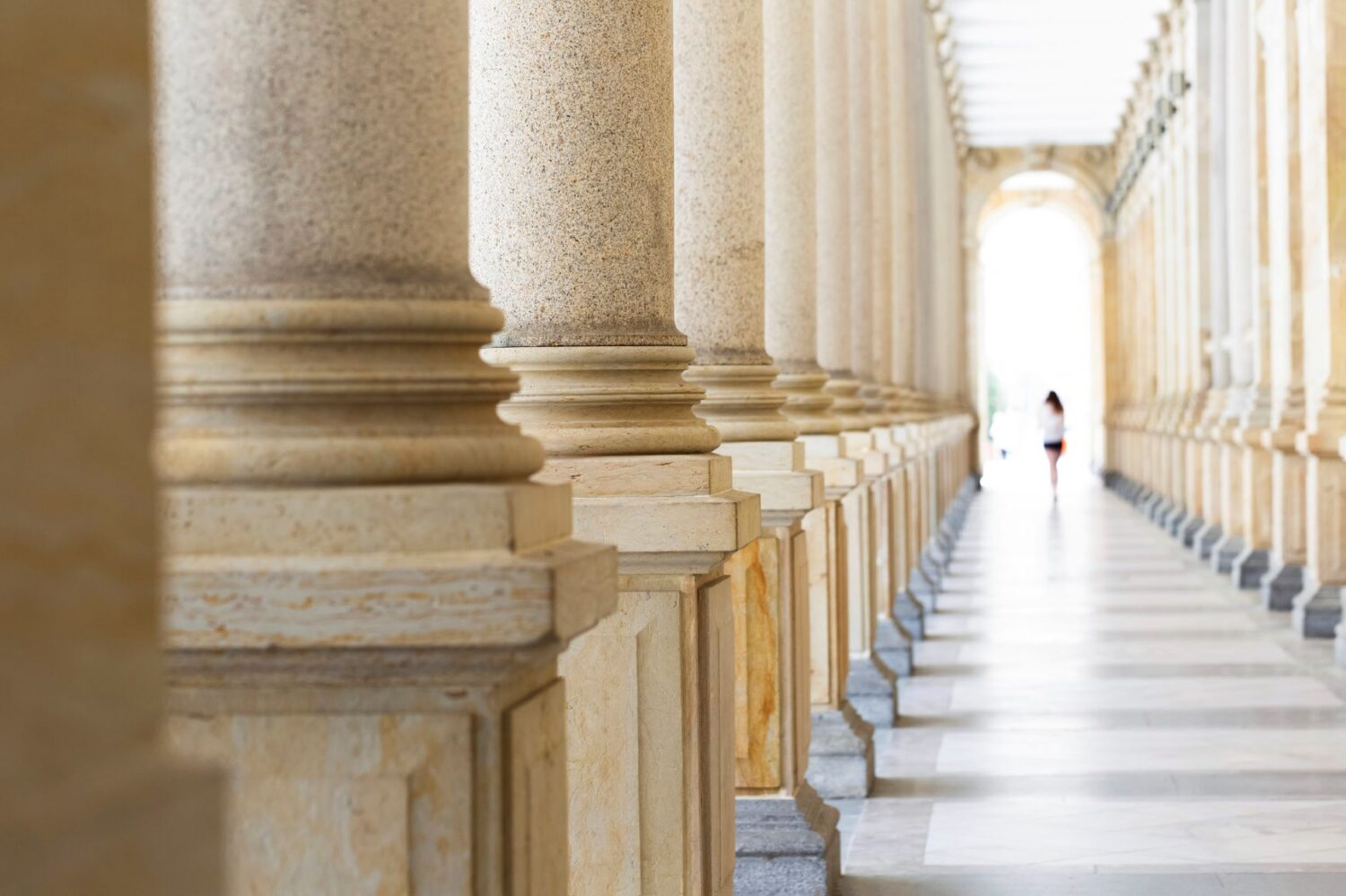 Colonnade, row of classical stone columns, background with copy spaced