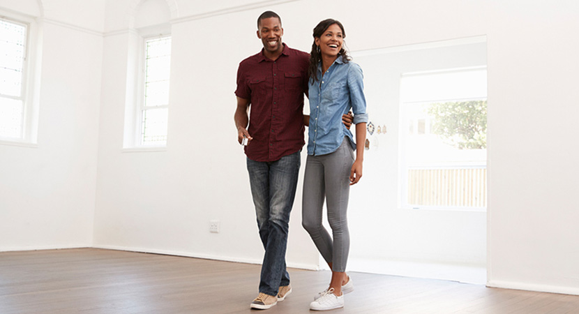 Young couple touring an empty house.