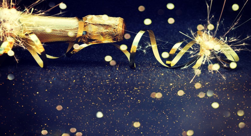 Champagne bottle and gold streamers