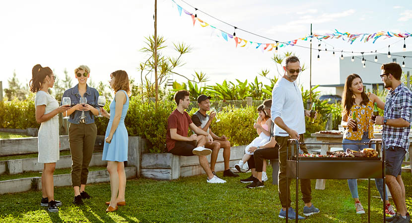 Young adults enjoying a BBQ outside