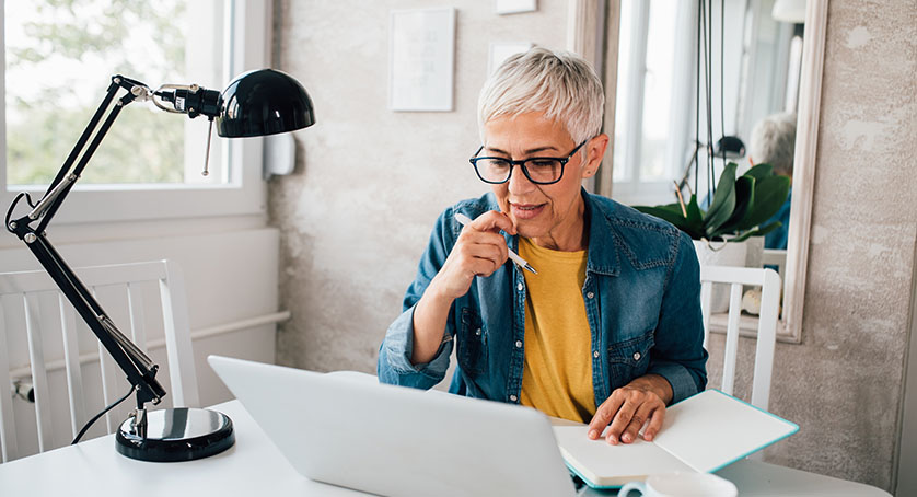 Mature woman working online